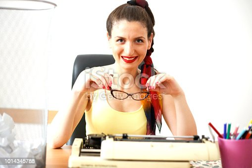 istock Young woman typing with a typewriter 1014345788