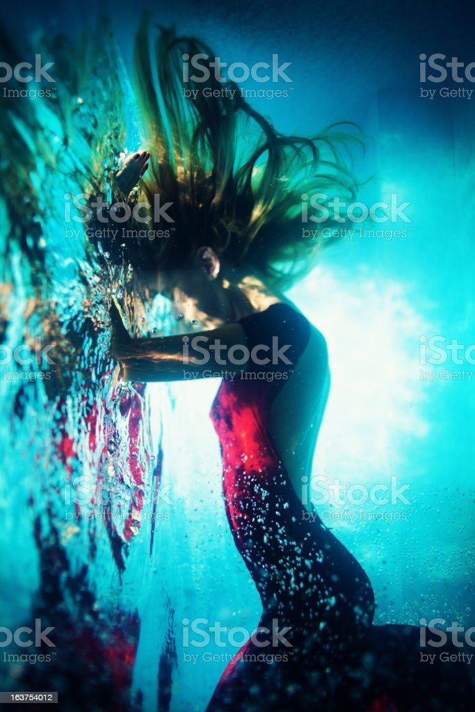 Young woman underwater stock photo