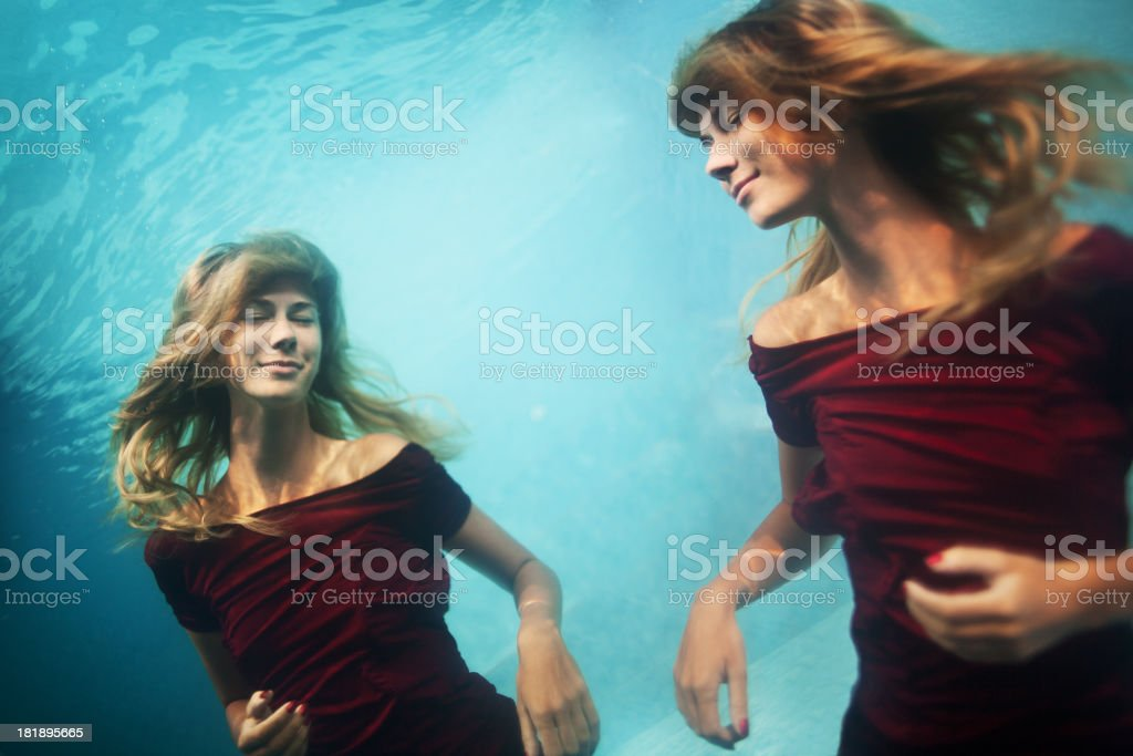 Young woman underwater royalty-free stock photo