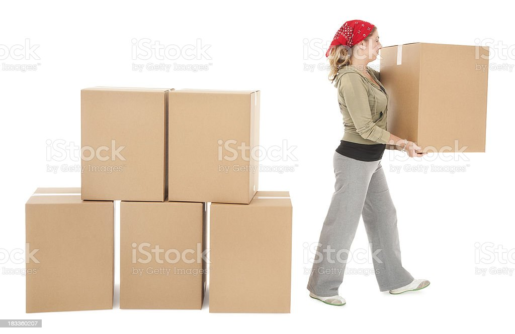 Young Woman Unstacking Cardboard Moving Boxes royalty-free stock photo