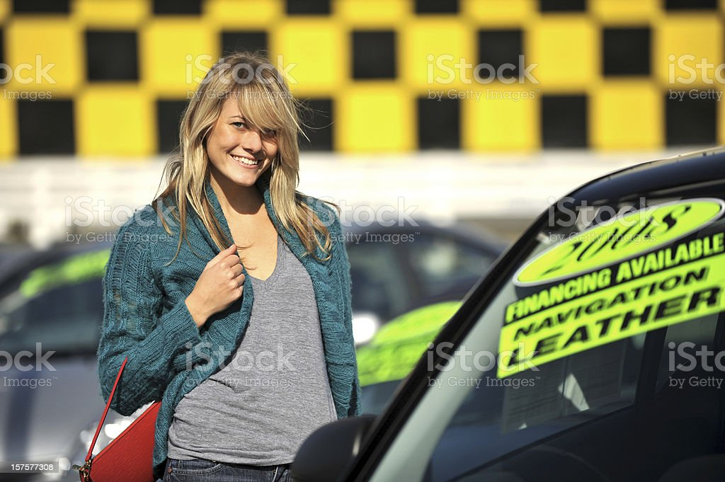 Young Woman Used Car Shopping stock photo