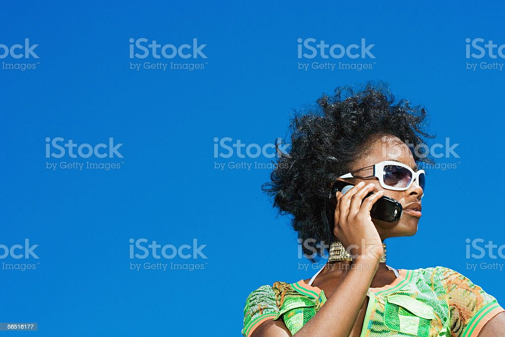 Young woman using a cellular telephone royalty-free stock photo