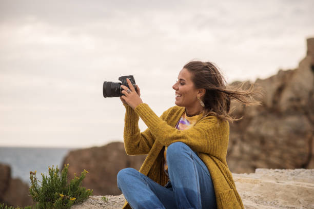 Young woman using a dslr camera in a beautiful coast area picture id1250078267?b=1&k=6&m=1250078267&s=612x612&w=0&h=mfshtkbknvzq2zj7doqiqy1atdc1mhfu ech9c guhm=
