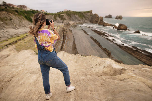 Young woman using a dslr camera in a beautiful coast area picture id1250225481?b=1&k=6&m=1250225481&s=612x612&w=0&h=qzwh6rsnftzmbwmbizys a 1f5a2v18eou 9qbznz0w=