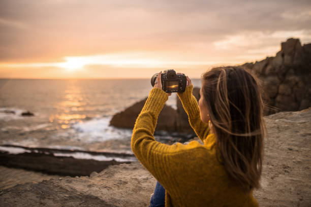 Young woman using a dslr camera in a beautiful coast area picture id1250225683?b=1&k=6&m=1250225683&s=612x612&w=0&h=w0mxpi1zhexcbwp1o kr dtw0virzitew6exnwqfofy=