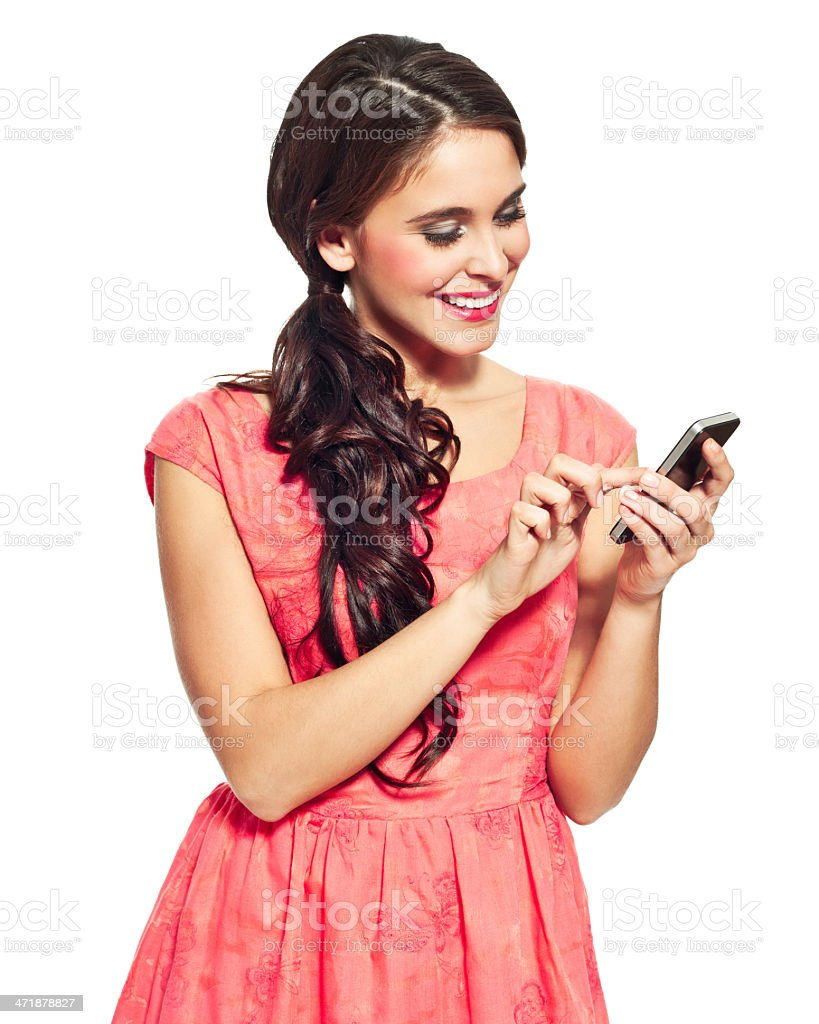 Young woman using a smart phone Portrait of beautiful young woman using a smart phone. Studio shot, white background. 20-24 Years Stock Photo