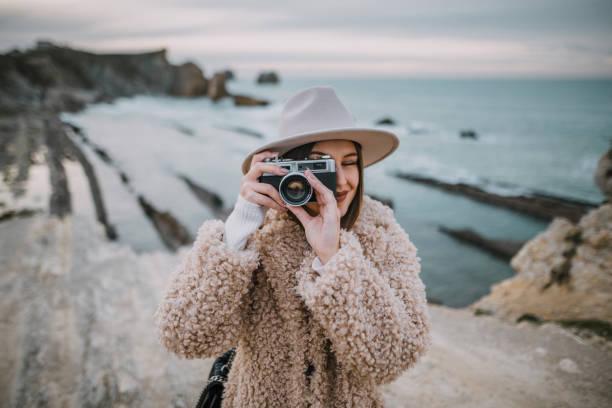 Young woman using a vintage camera picture id1082117114?b=1&k=6&m=1082117114&s=612x612&w=0&h=ye0 bracjblehzylnvmzpjslxouoso57xyf4b2vkto0=