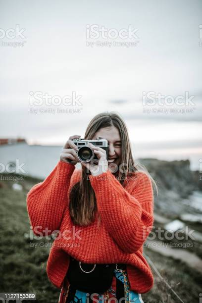 Young woman using a vintage camera picture id1127153369?b=1&k=6&m=1127153369&s=612x612&h=bly9csmsri9pccbsggd4k m0p2qc yfv 7enq6ds2wg=