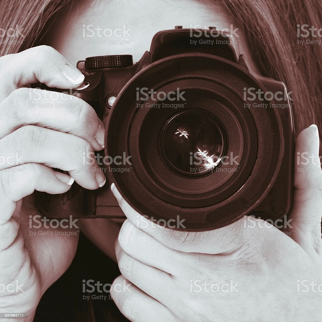 Young woman using camera stock photo