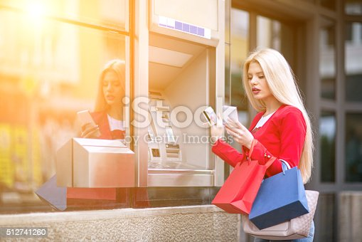 istock Young woman using credit card 512741260