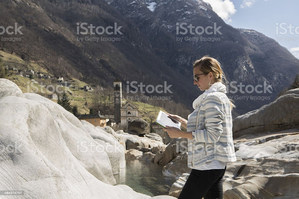 Young woman using digital tablet in nature royalty-free stock photo