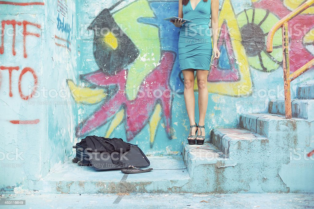 Young woman using digital tablet on the street royalty-free stock photo
