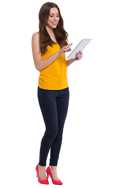 Young woman using digital tablet stock photo