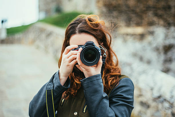 Young woman using dslr camera picture id524397144?b=1&k=6&m=524397144&s=612x612&w=0&h=hoibh5s5wjywr7520wwopf7ngcouz4doattu3ihcpxy=
