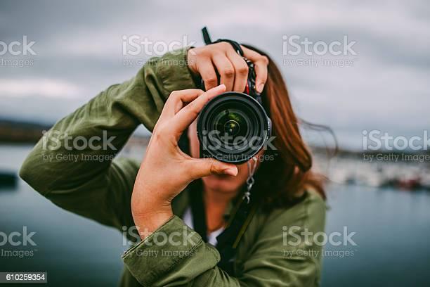 Young woman using dslr camera picture id610259354?b=1&k=6&m=610259354&s=612x612&h=ymihff1hxyyaktpvwjrqtmctsp90ceweowss3funrma=