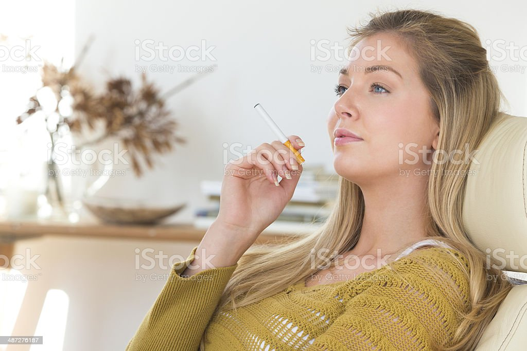 Young Woman Using Electric Cigarette stock photo