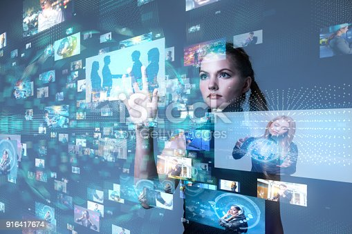 istock Young woman using futuristic interface. IoT(Internet of Things). ICT(Information Communication Network). Social media. 916417674