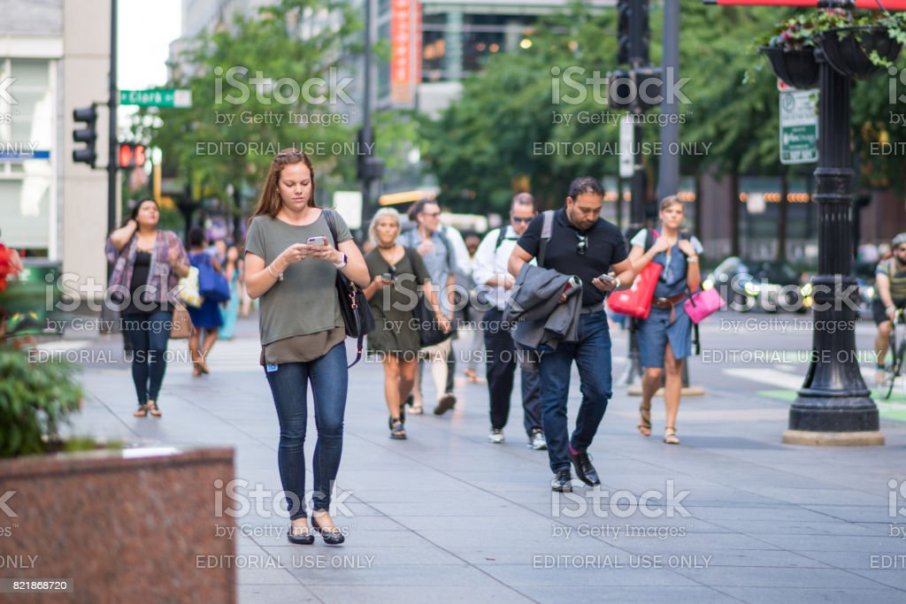 Young woman using her phone in the city stock photo