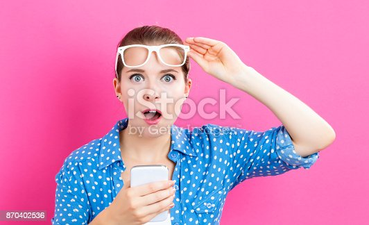 istock Young woman using her phone 870402536