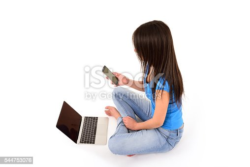 istock Young woman using laptop and phone 544753076