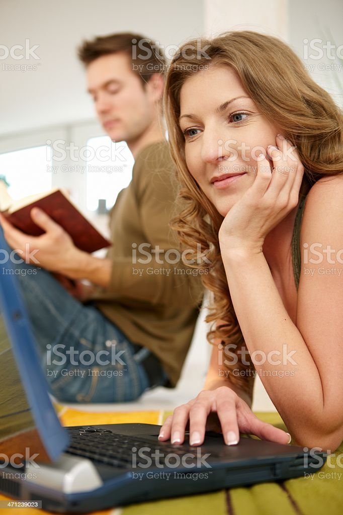 Young woman using laptop at home royalty-free stock photo