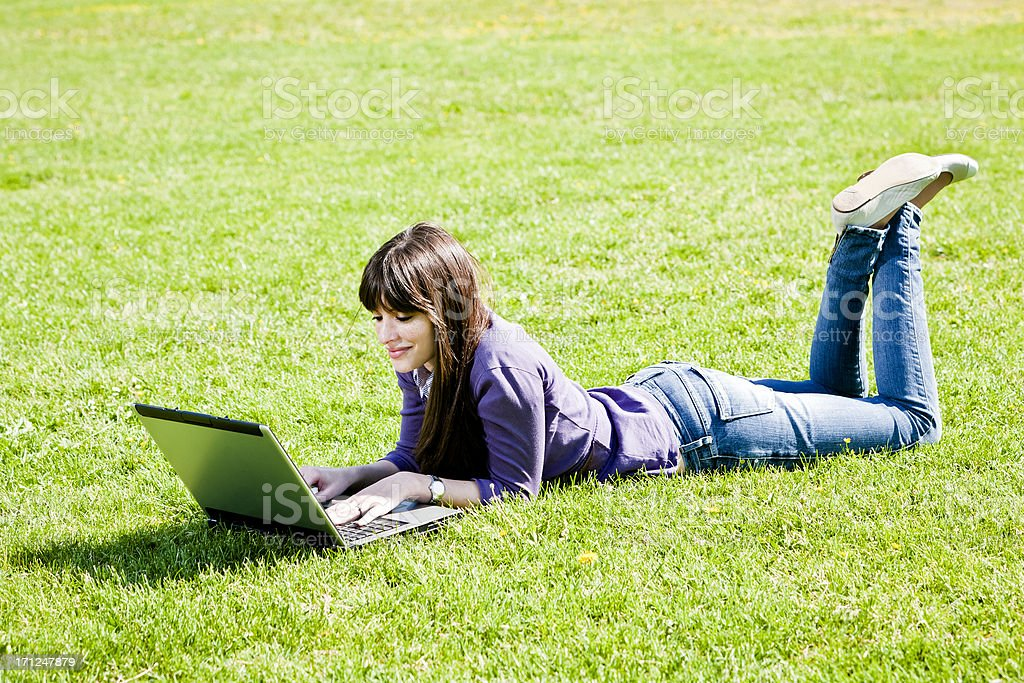 Young woman using laptop at the Park royalty-free stock photo
