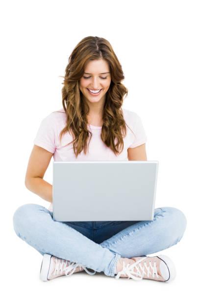 young woman using laptop - sitting laptop стоковые фото и изображения