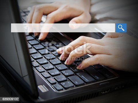 istock Young woman using laptop with blank search bar 639309102