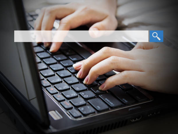 Young woman using laptop with blank search bar – Foto