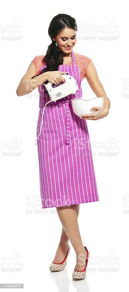 Young woman using mixer Full lenght portrait of cheerful young housewife using a electric mixer. 20-24 Years Stock Photo