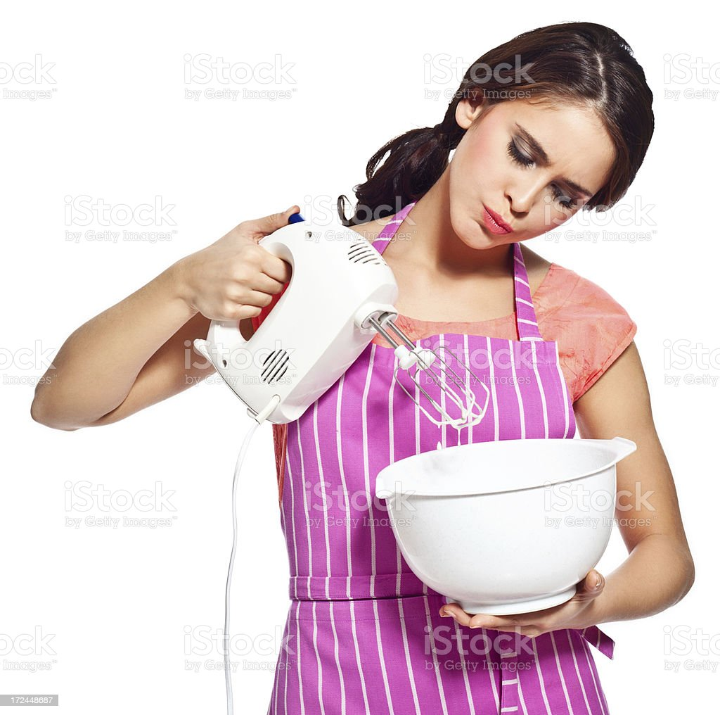 Young woman using mixer Portrait of worried young housewife using a electric mixer. 20-24 Years Stock Photo