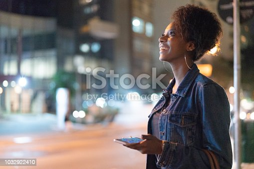 istock Young Woman Using Mobile at City 1032922410