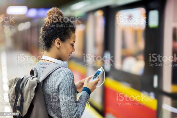 Young Woman Using Mobile Phone On Subway Stock Photo - Download Image Now