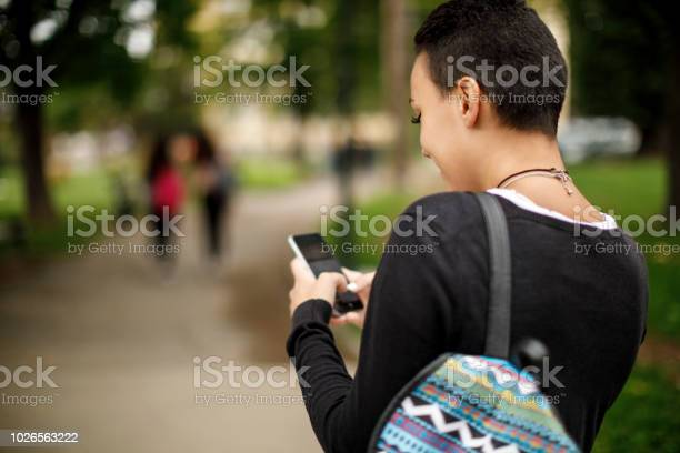 Young woman using mobile phone outdoors picture id1026563222?b=1&k=6&m=1026563222&s=612x612&h=2fvmmngblx7ab39wsfsllld9ywh5am5 dxyipbgokhu=