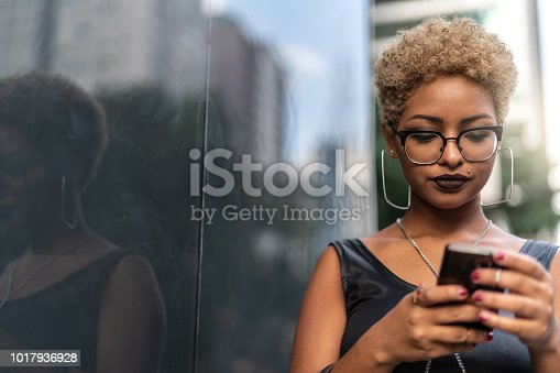 istock Young Woman Using Mobile 1017936928