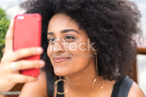 946192604 istock photo Young Woman Using Mobile 1039344478