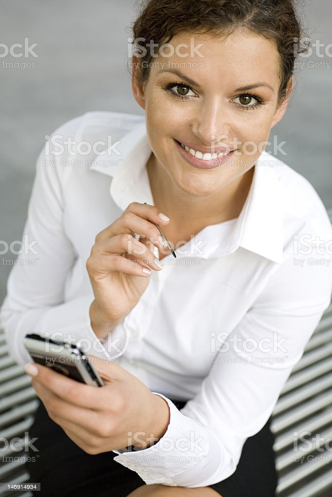 Young woman using palmtop royalty-free stock photo