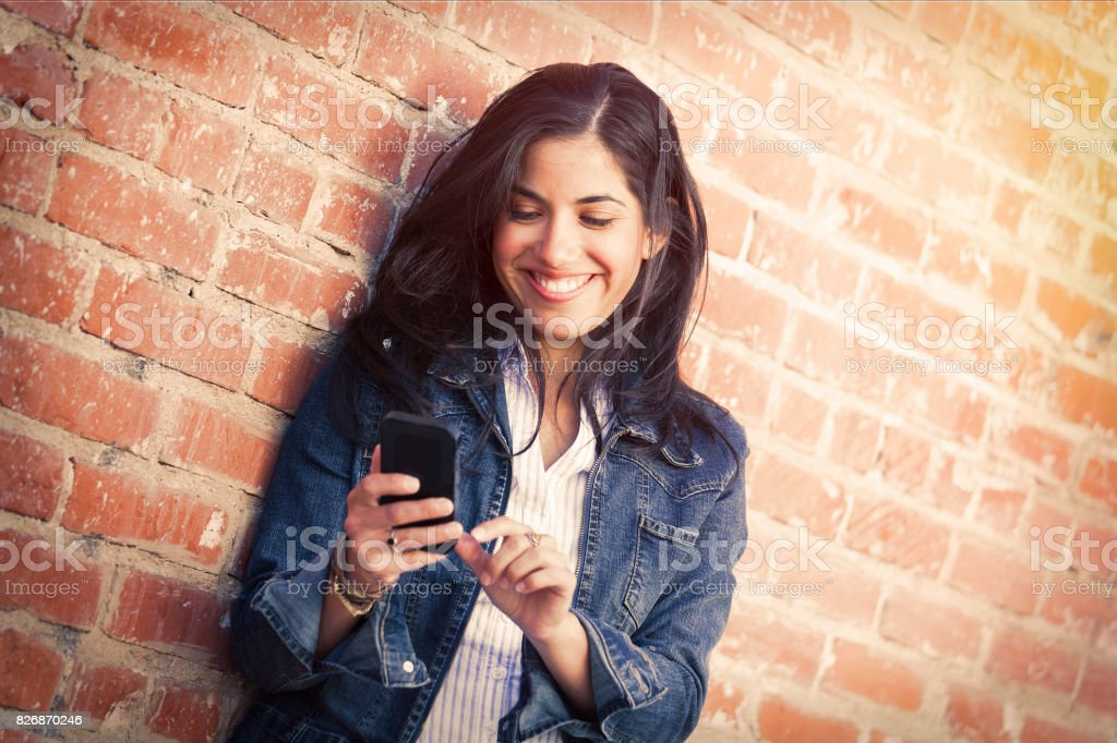 Young woman using phone stock photo