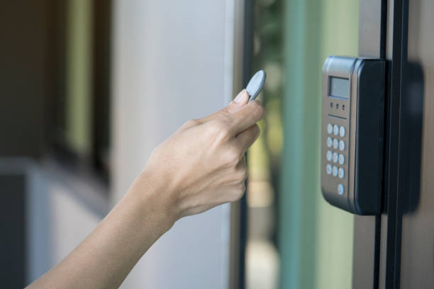 young woman using RFID tag key to open the door young woman using RFID tag key to open the door radio frequency identification stock pictures, royalty-free photos & images
