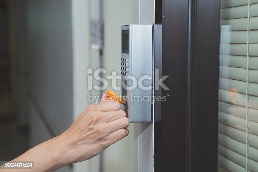 istock young woman using RFID tag key to open the door 902401524