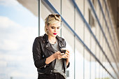 Young woman using smart phone at airport
