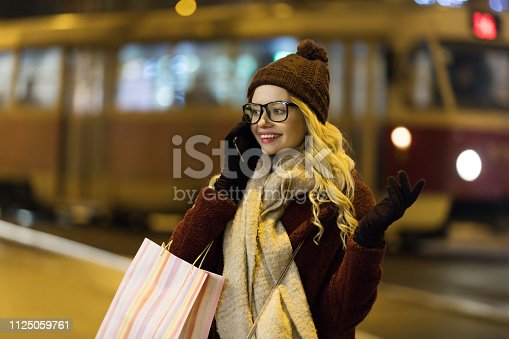 Young woman using smart phone in city