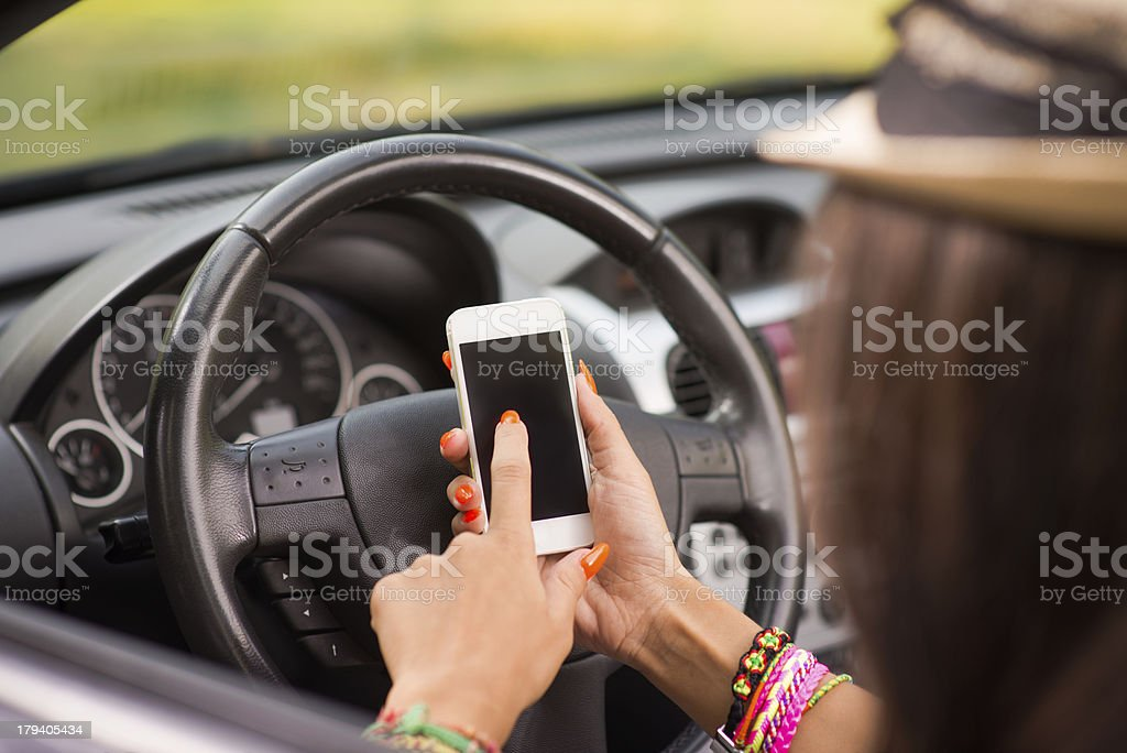 Young woman using smart phone in his car royalty-free stock photo