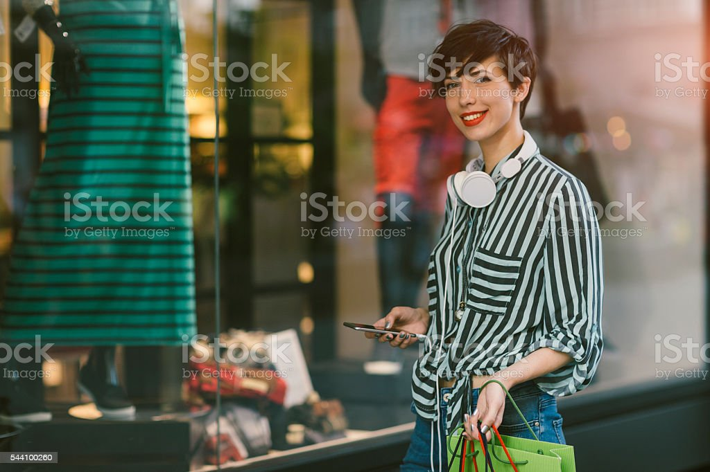 Young Woman Using Smart Phone In The City stock photo