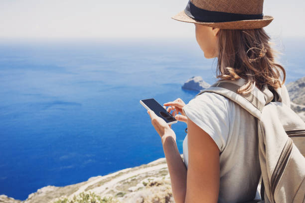 Young woman using smart phone on vacations stock photo
