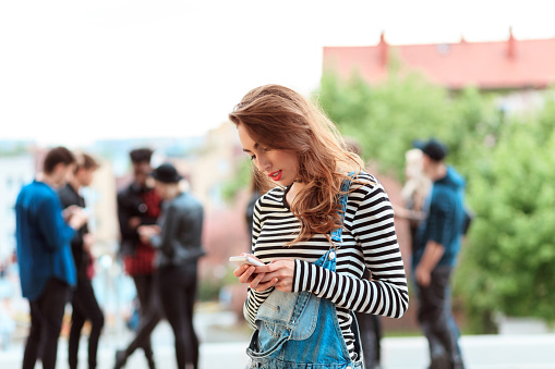 Young Woman Using Smart Phone Outdoor Stock Photo - Download Image Now