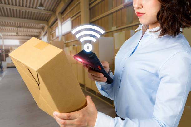young woman using tablet PC in warehouse. industrial technology concept. factory automation. Industry4.0 young woman using tablet PC in warehouse. industrial technology concept. factory automation. Industry4.0 radio frequency identification stock pictures, royalty-free photos & images