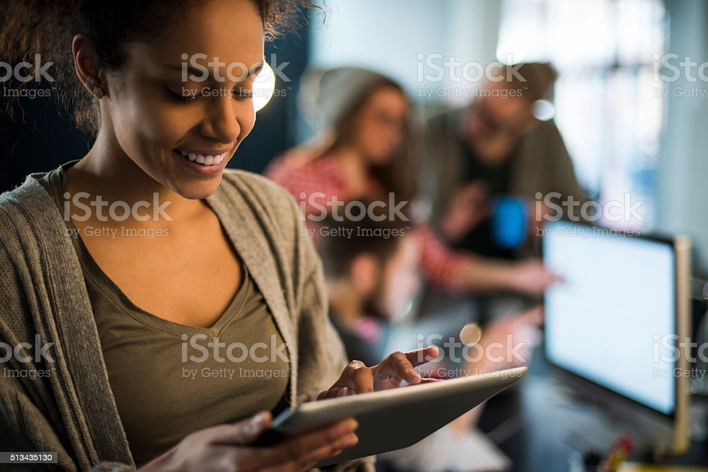 Young woman using tablet stock photo