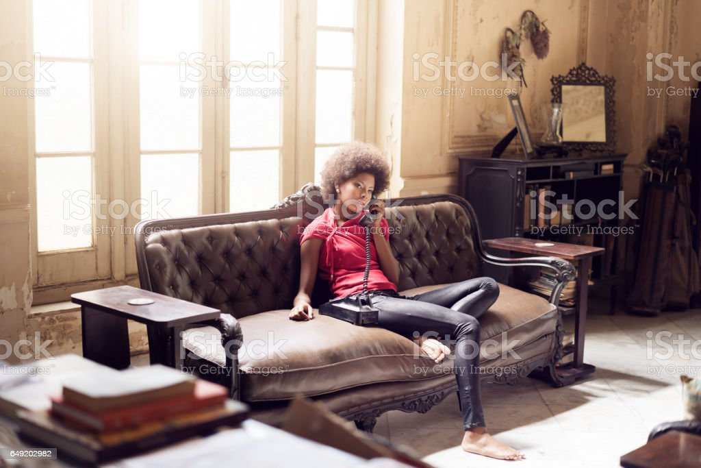 young woman using telephone, Havana, Cuba stock photo