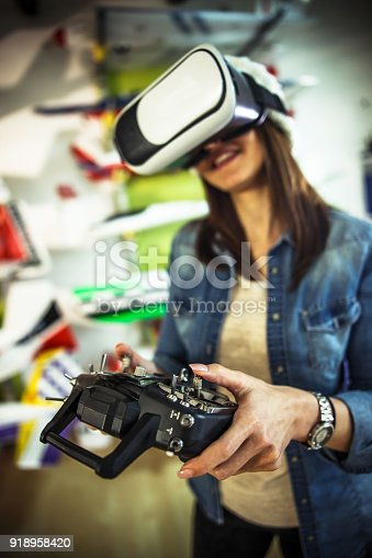 istock Young woman using the virtual reality headset 918958420